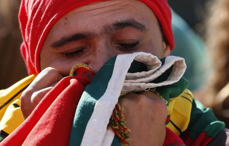 A Portugal fan reacts during the team's Group G World Cup soccer match against Ghana at a public screening in Lisbon June 26, 2014. (Hugo Correia/Reuters photo)