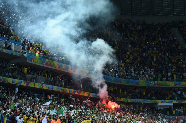 Algeria fans celebrate their team's first goal during the 2014 FIFA World Cup Brazil Group H match between Algeria and Russia at Arena da Baixada on June 26, 2014 in Curitiba, Brazil. (Matthias Hangst/Getty Images)