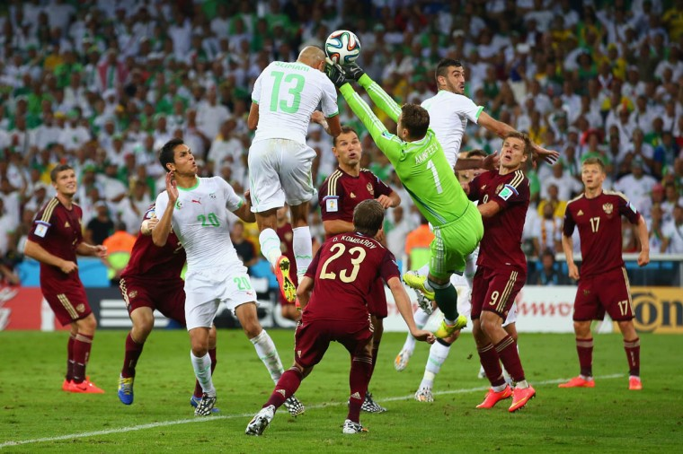 Islam Slimani of Algeria scores his team's first goal on a header past Igor Akinfeev of Russia during the 2014 FIFA World Cup Brazil Group H match between Algeria and Russia at Arena da Baixada on June 26, 2014 in Curitiba, Brazil. (Julian Finney/Getty Images)