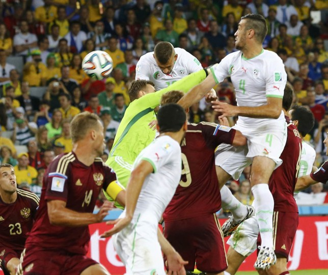 Algeria's Islam Slimani (Center, top) heads the ball to score a goal against Russia during their 2014 World Cup Group H soccer match at the Baixada arena in Curitiba June 26, 2014. (Murad Sezer/Reuters photo)