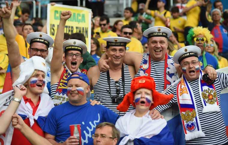 Russia fans cheer during the 2014 FIFA World Cup Brazil Group H match between Algeria and Russia at Arena da Baixada on June 26, 2014 in Curitiba, Brazil. (Matthias Hangst/Getty Images)