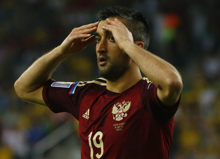 Russia's Alexander Samedov reacts after missing a chance to score a goal against Algeria during their 2014 World Cup Group H soccer match at the Baixada arena in Curitiba June 26, 2014. (Damir Sagolj/Reuters photo)