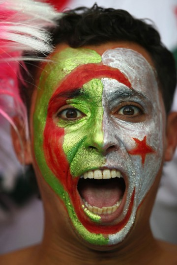 An Algeria fan cheers during the 2014 FIFA World Cup Brazil Group H match between Algeria and Russia at Arena da Baixada on June 26, 2014 in Curitiba, Brazil. (Clive Rose/Getty Images)