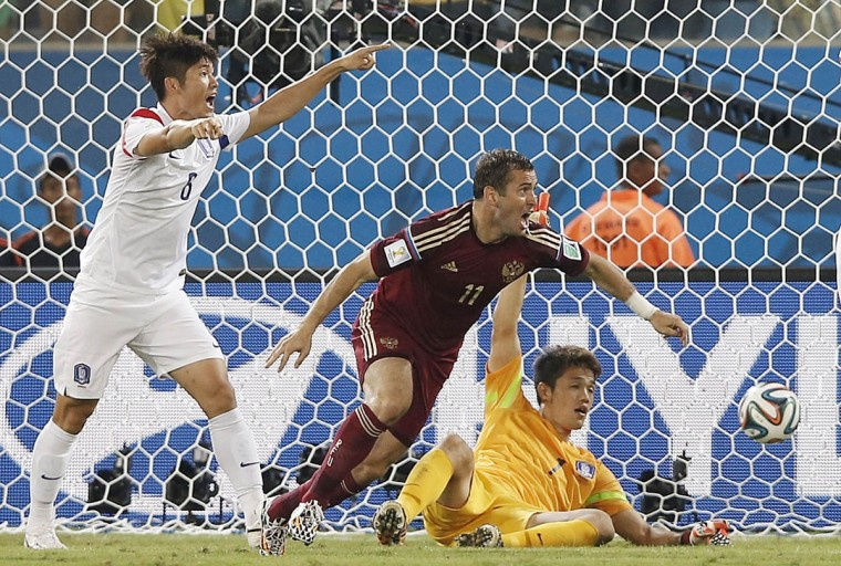 Russia's forward Alexander Kerzhakov (Center) reacts after scoring past South Korea's goalkeeper Jung Sung-Ryong during the Group H football match between Russia and South Korea in the Pantanal Arena in Cuiaba during the 2014 FIFA World Cup on June 17, 2014. (Adrian Dennis/Getty Images)