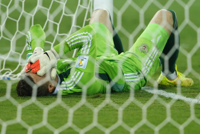 Russia's goalkeeper Igor Akinfeev reacts to conceding a goal to South Korea's Lee Keun-ho (not pictured) during their 2014 World Cup Group H soccer match against South Korea at the Pantanal arena in Cuiaba June 17, 2014. (Eddie Keogh/Reuters photo)