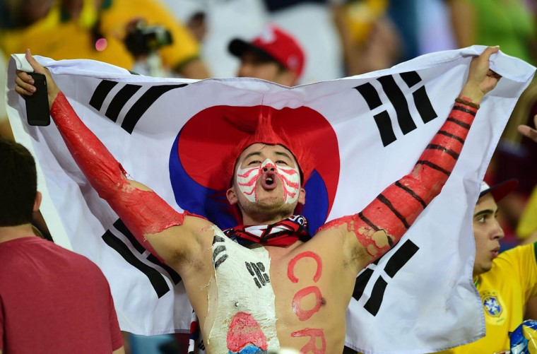 A South Korean fan reacts during a Group H football match between Russia and South Korea in the Pantanal Arena in Cuiaba during the 2014 FIFA World Cup on June 17, 2014. ( Jung Yeon-Je/Getty Images)