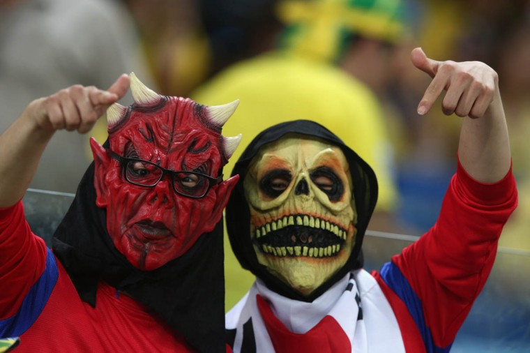 South Korea fans pose with masks during the 2014 FIFA World Cup Brazil Group H match between Russia and South Korea at Arena Pantanal on June 17, 2014 in Cuiaba, Brazil. (Adam Pretty/Getty Images)