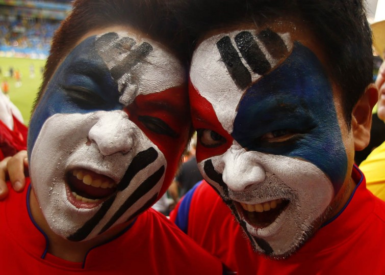 Fans of South Korea pose during the 2014 World Cup Group H soccer match against Russia at the Pantanal arena in Cuiaba June 17, 2014. (Eddie Keogh/Reuters photo)