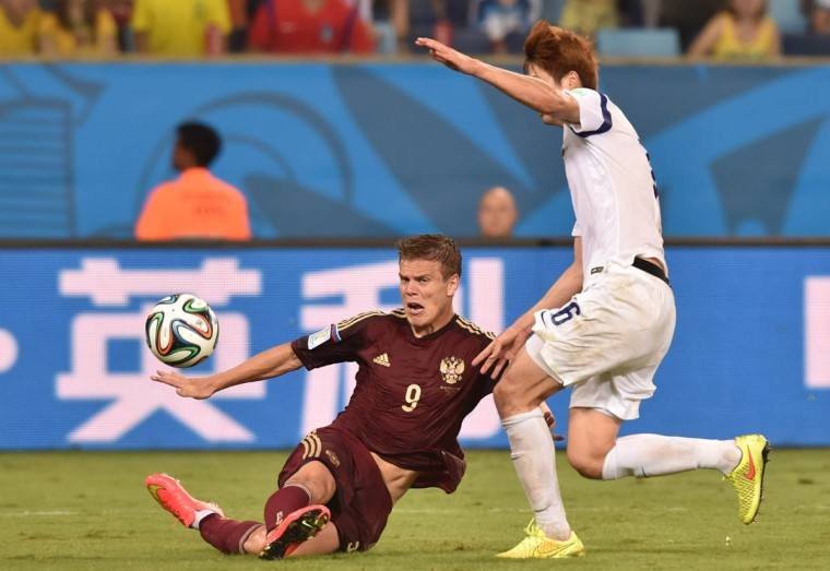 Russia's forward Alexander Kokorin (Left) and South Korea's defender Hwang Seok-Ho vie during the Group H football match between Russia and South Korea in the Pantanal Arena in Cuiaba during the 2014 FIFA World Cup on June 17, 2014. (Kirill Kudryavtsev/Getty Images)
