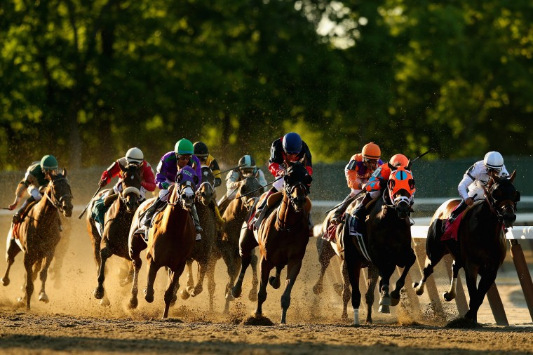 The field rounds the final turn during the 146th running of the Belmont Stakes at Belmont Park in Elmont, N.Y. (Mike Ehrmann/Getty Images)