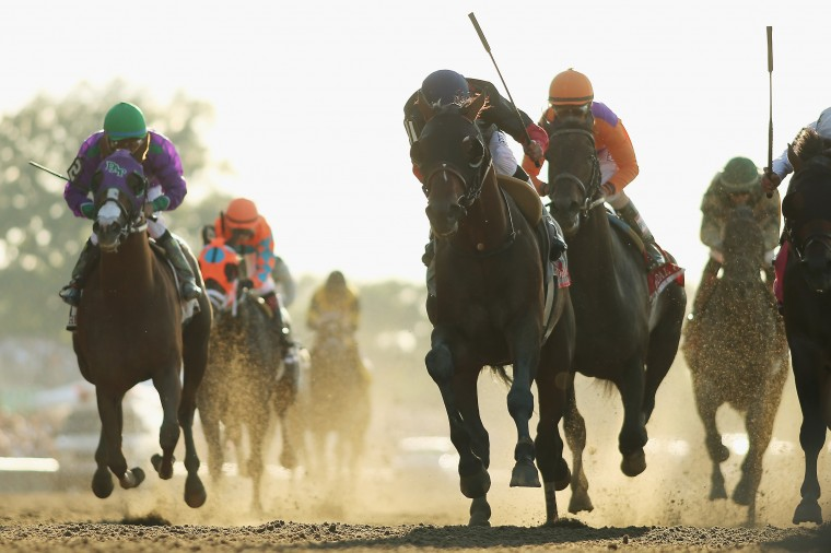 Tonalist (11,) ridden by Joel Rosario, races to the finish line enroute to winning the 146th running of the Belmont Stakes at Belmont Park in Elmont, N.Y. (Rob Carr/Getty Images)
