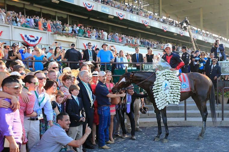 Tonalist (11) and jockey Joel Rosario celebrate in the winner's circle after winning the 146th running of the Belmont Stakes at Belmont Park in Elmont, N.Y. (Rob Carr/Getty Images)