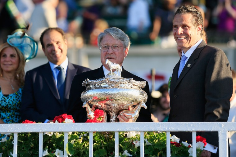 Tonalist owner Robert S. Evans holds the Belmont Stakes trophy after being presented by New York Gov. Andrew Cuomo after winning the 146th running of the race at Belmont Park in Elmont, New York. (Rob Carr/Getty Images)
