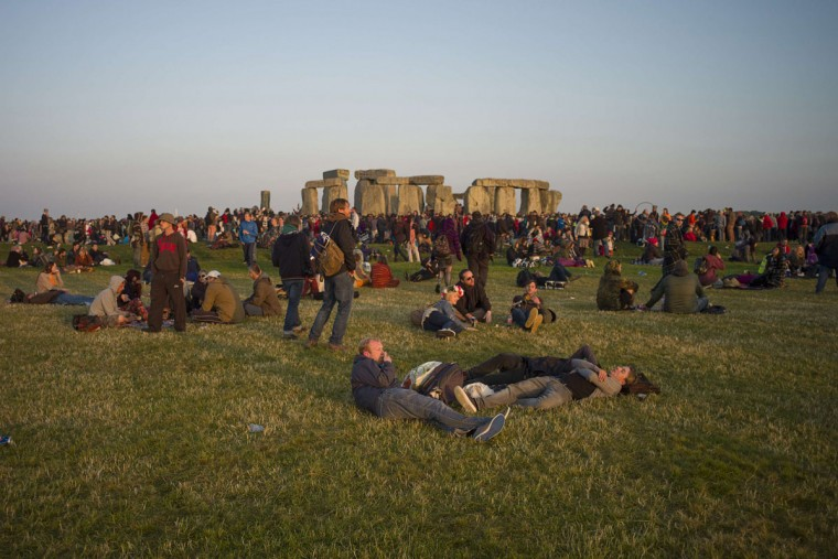 Revellers celebrate the summer solstice on Salisbury Plain in southern England June 21, 2014. Stonehenge is a celebrated venue of festivities during the summer solstice - the longest day of the year in the northern hemisphere - and it attracts thousands of revellers, spiritualists and tourists. Druids, a pagan religious order dating back to Celtic Britain, believe Stonehenge was a centre of spiritualism more than 2,000 years ago. (Kieran Doherty/Reuters)