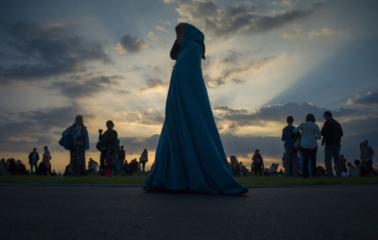 Revellers arrive to celebrate tomorrow's summer solstice at the Stonehenge monument on Salisbury Plain in southern England June 20, 2014. Druids and revellers make the annual pilgrimage to the site to celebrate the longest day of the year. (Kieran Doherty/Reuters)