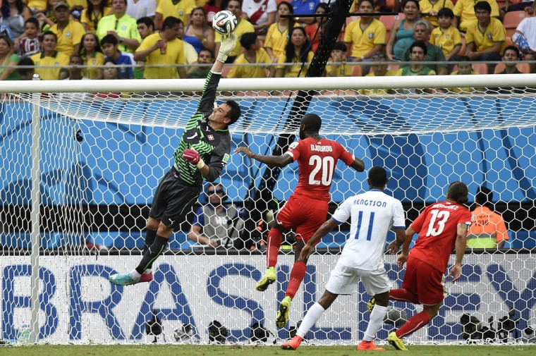 Switzerland's goalkeeper Diego Benaglio (Left) punches the ball away during the Group E football match between Honduras and Switzerland at the Amazonia Arena in Manaus during the 2014 FIFA World Cup on June 25, 2014. (Juan Barreto/Getty Images)