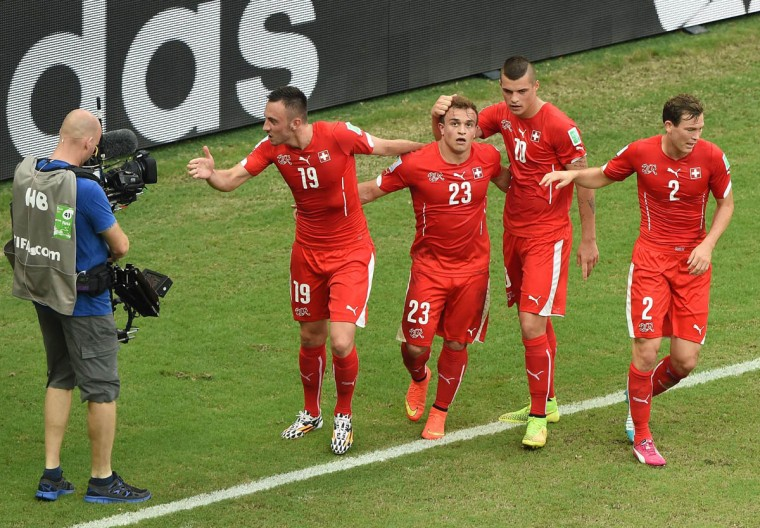Switzerland's midfielder Xherdan Shaqiri (2nd, Left) celebrates with Switzerland's forward Josip Drmic (Left), Switzerland's midfielder Granit Xhaka and Switzerland's defender Stephan Lichtsteiner (Right) after scoring during a Group E football match between Honduras and Switzerland at the Amazonia Arena in Manaus during the 2014 FIFA World Cup on June 25, 2014. (Luis Acosta/Getty Images)