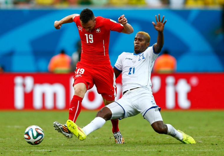 Brayan Beckeles of Honduras challenges Josip Drmic of Switzerland during the 2014 FIFA World Cup Brazil Group E match between Honduras and Switzerland at Arena Amazonia on June 25, 2014 in Manaus, Brazil. (Phil Walter/Getty Images)