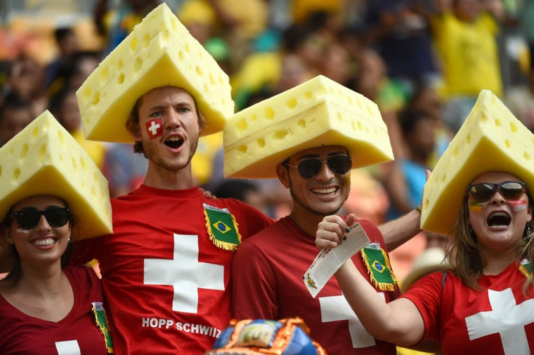Swiss fans cheer for their team before the start of the Group E football match between Honduras and Switzerland at the Amazonia Arena in Manaus during the 2014 FIFA World Cup on June 25, 2014. (Anne-Christine Poujoulat/Getty Images)