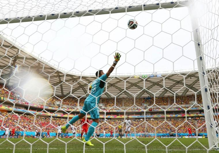 Xherdan Shaqiri of Switzerland (ground) scores his team's first goal past goalkeeper Noel Valladares of Honduras during the 2014 FIFA World Cup Brazil Group E match between Honduras and Switzerland at Arena Amazonia on June 25, 2014 in Manaus, Brazil. (Matthew Lewis/Getty Images)