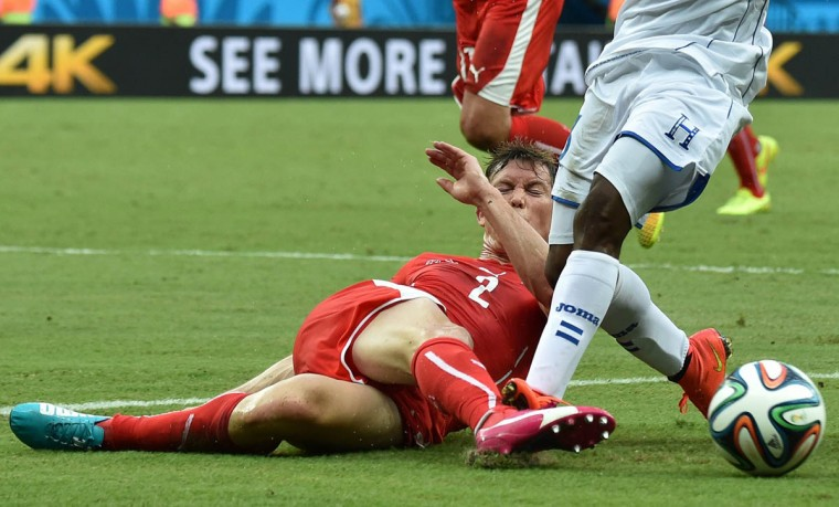 Switzerland's defender Stephan Lichtsteiner kicks the ball during a Group E football match between Honduras and Switzerland at the Amazonia Arena in Manaus during the 2014 FIFA World Cup on June 25, 2014. (Rodrigo Arangua/Getty Images)