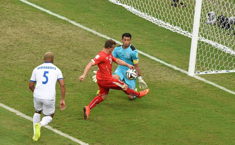 Switzerland's midfielder Xherdan Shaqiri has a shot at the goal in front of Honduras' defender Victor Bernardez and Honduras' goalkeeper and captain Noel Valladares (Right) during a Group E football match between Honduras and Switzerland at the Amazonia Arena in Manaus during the 2014 FIFA World Cup on June 25, 2014. (Luis Acosta/Getty Images)