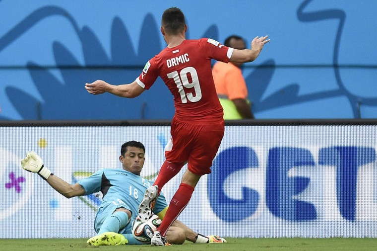 Honduras' goalkeeper Noel Valladares (back) blocks a shot on goal by Switzerland's forward Josip Drmic during the Group E football match between Honduras and Switzerland at the Amazonia Arena in Manaus during the 2014 FIFA World Cup on June 25, 2014. ( Juan Barreto/Getty Images)