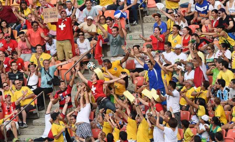 Fans grab the ball in the stands during a Group E football match between Honduras and Switzerland at the Amazonia Arena in Manaus during the 2014 FIFA World Cup on June 25, 2014. (Luis Acosta/Getty Images)