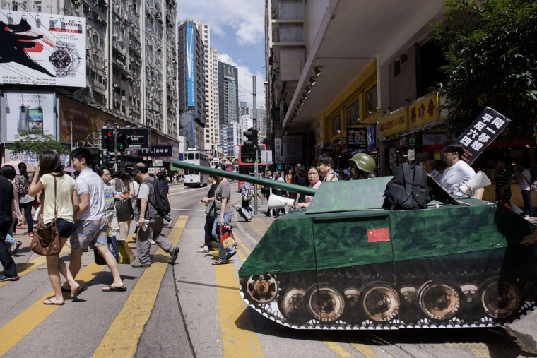 Activists push a replica of a Chinese tank across a street in Hong Kong to commemorate the 1989 Tiananmen Square military crackdown in Beijing on pro-democracy protesters, on June 4, 2014. Up to 200,000 people were set to take part in a candlelight vigil in Hong Kong on June 4 to commemorate the 25th anniversary of the bloody Tiananmen Square crackdown, as China seeks to wipe the incident from memory. (Alex Ogle/AFP/Getty Images)