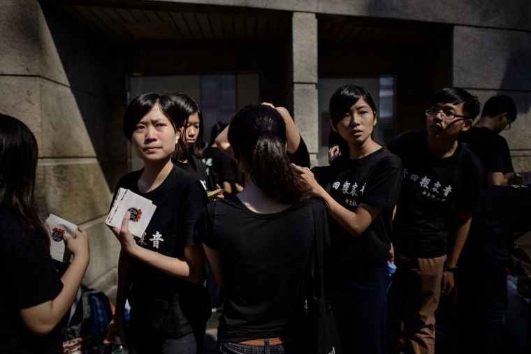 Students distribute leaflets to commemorate China's 1989 Tiananmen Square military crackdown on pro-democracy protesters, in Hong Kong on June 4, 2014. (PHILIPPE LOPEZ/AFP/Getty Images)