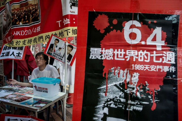 A man stands at a booth distributing leaflets and pro democracy material to commemorate China's 1989 Tiananmen Square military crackdown on pro-democracy protesters, in Hong Kong on June 4, 2014. (PHILIPPE LOPEZ/AFP/Getty Images)