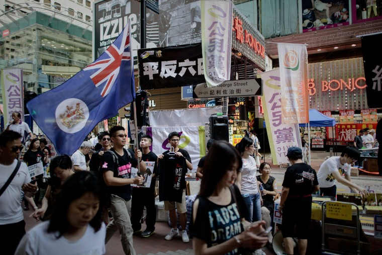 A man carries a Hong Kong colonial flag as part of the commemoration of China's 1989 Tiananmen Square military crackdown on pro-democracy protesters, in Hong Kong on June 4, 2014. (PHILIPPE LOPEZ/AFP/Getty Images)