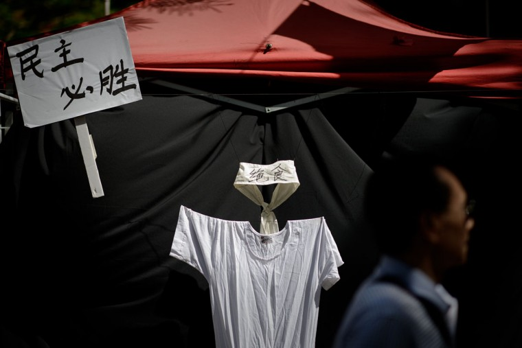 A man walks past a T-shirt and a headband displayed to symbolize the hunger strike of pro democracy activists during China's 1989 Tiananmen Square events, ahead of a candlelight vigil in Hong Kong on June 4, 2014. (PHILIPPE LOPEZ/AFP/Getty Images)