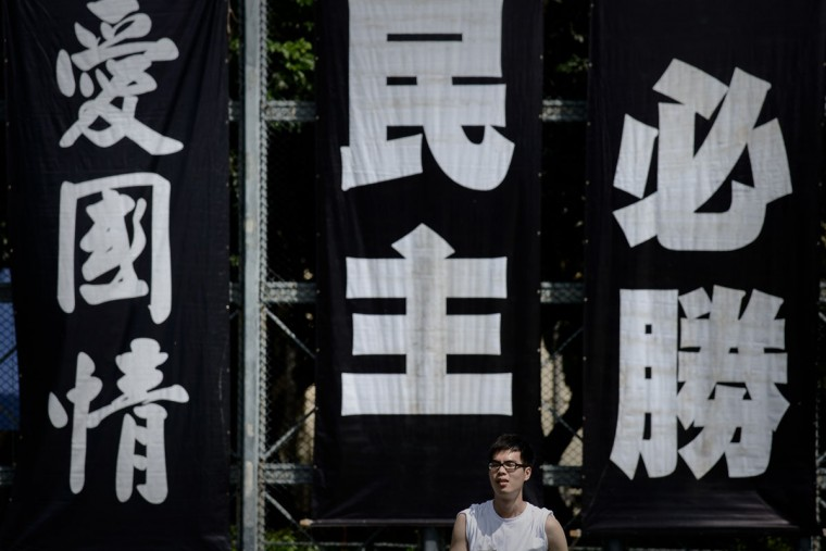 A man walks past banners set up to commemorate China's 1989 Tiananmen Square military crackdown on pro-democracy protesters, in Hong Kong on June 4, 2014. (PHILIPPE LOPEZ/AFP/Getty Images)
