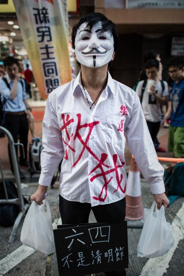 A man wears a mask and poses as a victim to commemorate China's 1989 Tiananmen Square events ahead of a candlelight vigil in Hong Kong on June 4, 2014. (PHILIPPE LOPEZ/AFP/Getty Images)