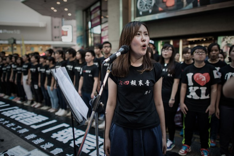 Students sing to commemorate China's 1989 Tiananmen Square events ahead of a candlelight vigil in Hong Kong on June 4, 2014. (PHILIPPE LOPEZ/AFP/Getty Images)