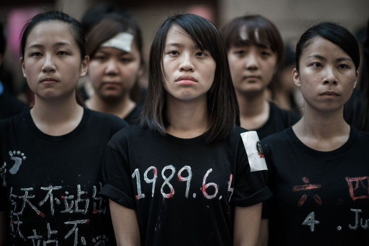 Students look on before singing to commemorate China's 1989 Tiananmen Square events ahead of a candlelight vigil in Hong Kong on June 4, 2014. (PHILIPPE LOPEZ/AFP/Getty Images)