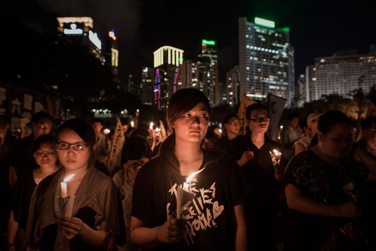 People hold candles to commemorate China's 1989 Tiananmen Square events during a candlelight vigil in Hong Kong on June 4, 2014. (PHILIPPE LOPEZ/AFP/Getty Images)