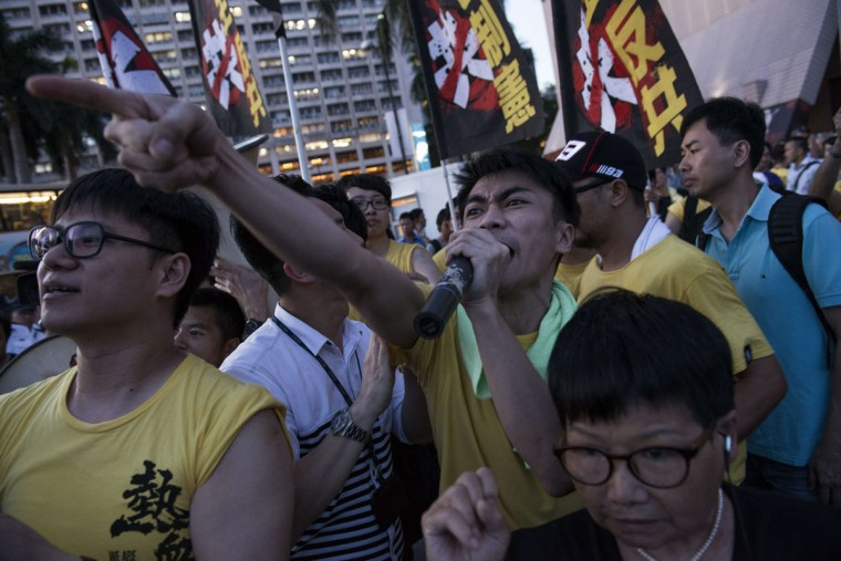 Pro-democracy activists scream at a pro-China group during a rally to mark the 1989 Tiananmen Square military crackdown, in Hong Kong on June 4, 2014. (Alex Ogle/AFP/Getty Images)