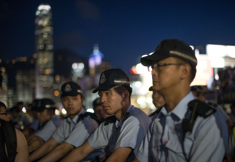 Hong Kong police officers line up as pro-democracy activists confront a pro-China group during a rally to mark the 1989 Tiananmen Square military crackdown, in Hong Kong on June 4, 2014. (Alex Ogle/AFP/Getty Images)
