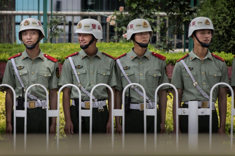 Chinese Paramilitary police stand guard near Tiananmen Square on June 4, 2014 in Beijing. (Photo by Kevin Frayer/Getty Images)