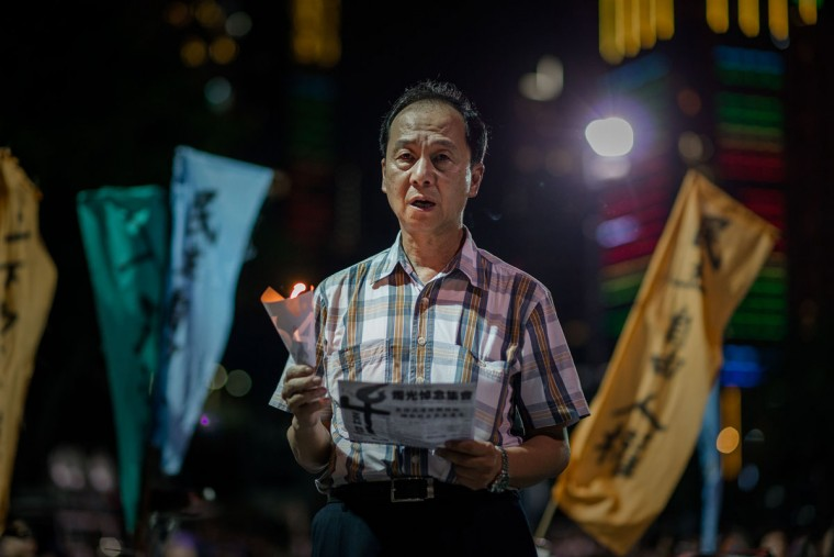 A man holds a candle to commemorate China's 1989 Tiananmen Square events during a candlelight vigil in Hong Kong on June 4, 2014. (PHILIPPE LOPEZ/AFP/Getty Images)