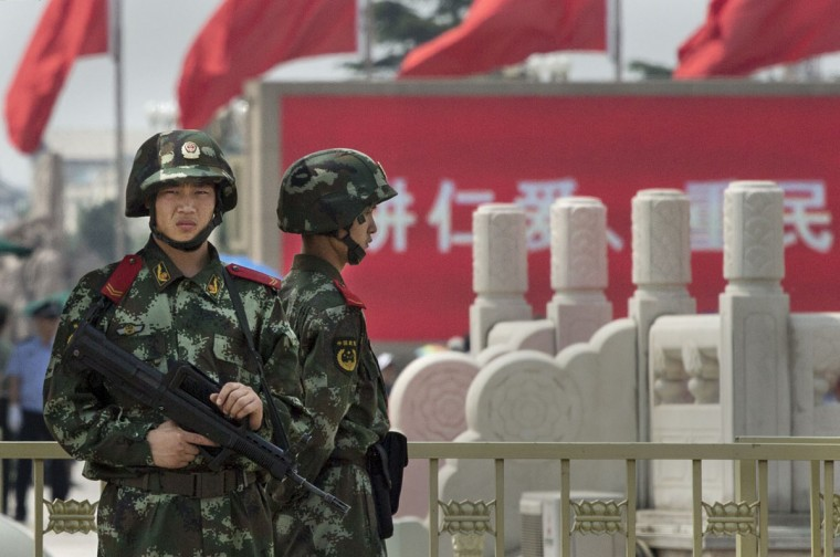 Chinese Paramilitary police stand guard in Tiananmen Square on June 4, 2014 in Beijing. (Photo by Kevin Frayer/Getty Images)
