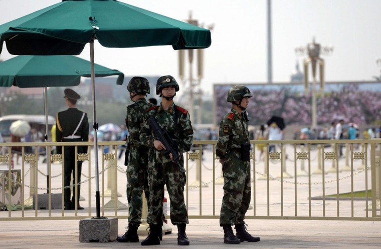 Armed Chinese police stand guard on Tiananmen Square in Beijing on June 4, 2014 on the 25th anniversary of the June 4, 1989 crackdown on pro-democracy protests. (GOH CHAI HIN/AFP/Getty Images)