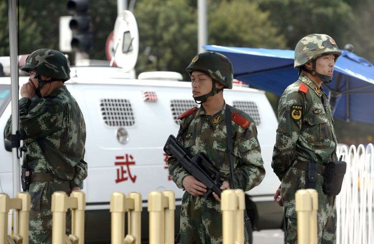 Armed Chinese police stand guard near Tiananmen Square in Beijing on June 4, 2014, on the 25th anniversary of the June 4, 1989 crackdown on pro-democracy protests. (GOH CHAI HIN/AFP/Getty Images)