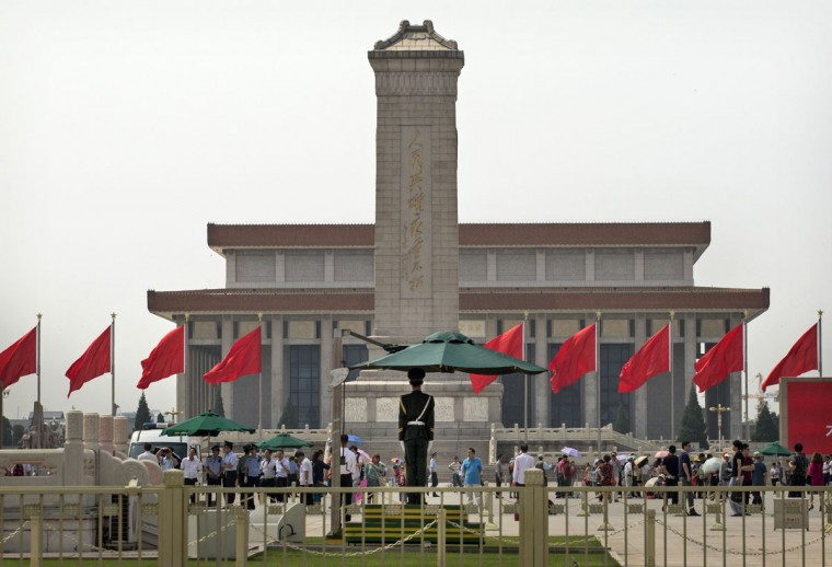 A Chinese Paramilitary soldier stands guard in Tiananmen Square on June 4, 2014 in Beijing. (Photo by Kevin Frayer/Getty Images)