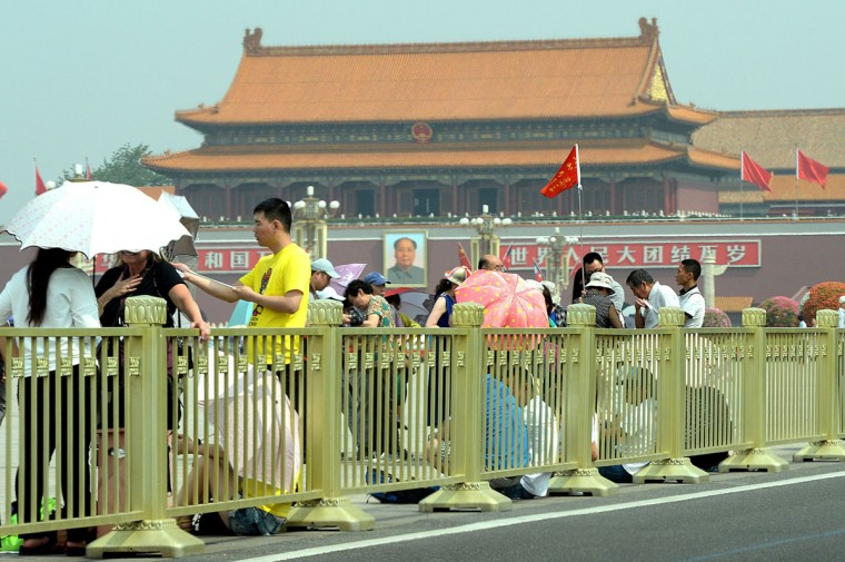 Visitors gather on Tiananmen Square in Beijing on June 4, 2014, on the 25th anniversary of the June 4, 1989 crackdown on pro-democracy protests. (GOH CHAI HIN/AFP/Getty Images)