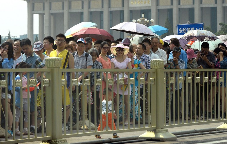 Visitors line up to enter Tiananmen Square in Beijing on June 4, 2014, on the 25th anniversary of the 1989 crackdown on pro-democracy protests. The Tiananmen pro-democracy protests were crushed on the night of June 3-4, 1989, when soldiers killed hundreds of unarmed civilians -- and by some estimates, more than 1,000. (GOH CHAI HIN/AFP/Getty Images)