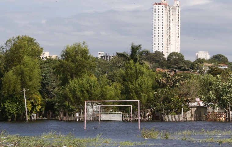 Goalposts stand in a soccer field flooded by the waters of the Paraguay River in Asuncion, Paraguay on May 30, 2014. (REUTERS/Jorge Adorno)