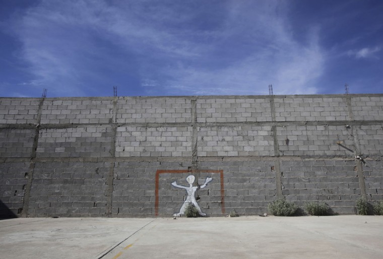 A goalpost is painted on a wall at a house used as a creche in Ciudad Juarez, Mexico on June 3, 2014. (REUTERS/Jose Luis Gonzalez)